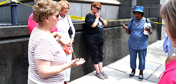 A group of women pray the rosary outside of the Potter Stewart Courthouse in downtown Cincinnati on Wednesday, Aug. 6. The women pictured were part of a prayer gathering that took place as judges inside began a review of several marriage-related cases. (CT Photo/John Stegeman)