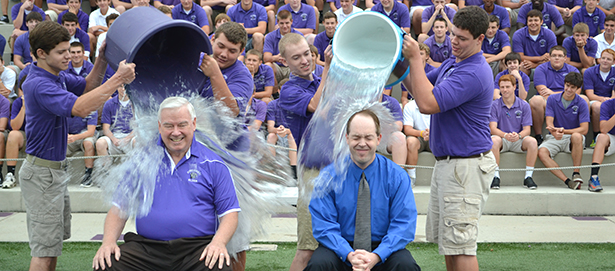 Superintendent of Catholic Schools Jim Rigg, right, and Elder Principal Tom Otten take the ALS Ice Bucket Challenge on Thursday, Aug. 21, 2014. Their donations went to the John Paul II Medical Research Institute in Iowa. (CT Photo/John Stegeman)