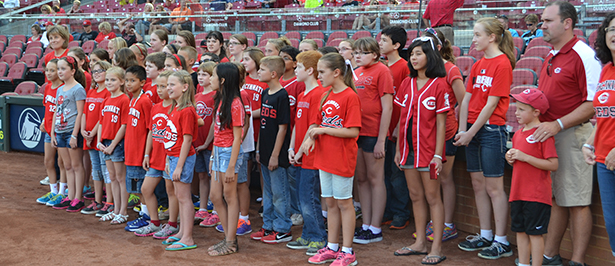 The St. Maximilian Kolbe Children's Choir sang the national anthem at the Cincinnati Reds' game Aug. 22. (CT Photo/John Stegeman)
