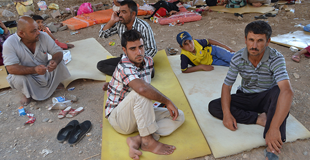 "Displaced people are seen resting on the ground at an area in Duhok, Iraq, Aug. 7. Given the ""grave situation in Iraq,"" Pope Francis has asked Cardinal Fernando Filoni, prefect of the Congregation for the Evangelization of Peoples, to travel to the region to meet church and government officials, but especially to meet Christians chased from their homes by militants of the Islamic State. (CNS photo/courtesy Christian Aid Program) See MIDEAST-PATRIARCHS, POPE-IRAQ and IRAQ-PRAYER Aug. 8, 2014."