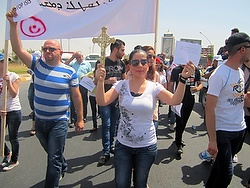Christian refugees march against persecution by Islamic State fighters outside the U.N. compound near the airport in Irbil, Iraq, July 24. Christians braved temperatures as high as 122 degrees Fahrenheit to make their voices heard. (CNS photo/Sahar Mansour)