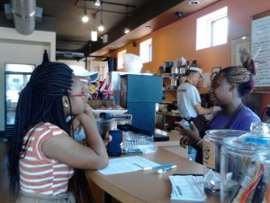 Ivy Bell, right, one of the worker/owners at Community Blend, assists customers.