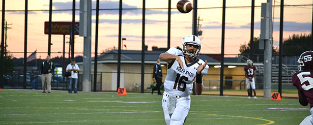 A Roger Bacon quarterback attempts a pass against Western Hills High School during the 2013 season. (CT Photo/John Stegeman)