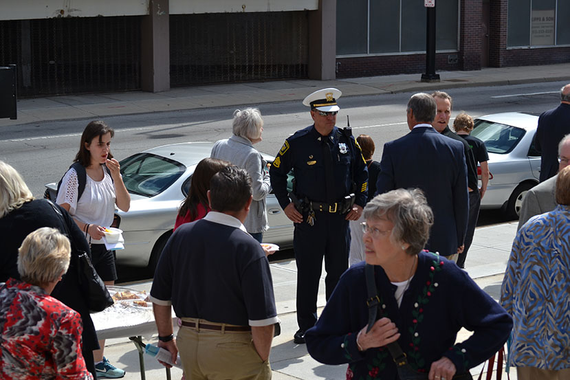 A police officer and others gather for a reception following the Sept. 14 Blue Mass at the Cathedral of St. Peter in Chains. (CT Photo/John Stegeman)