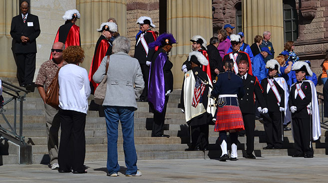 Knights of Columbus and a bagpiper mingle before the Sept. 14 Blue Mass at the Cathedral of St. Peter in Chains. (CT Photo/John Stegeman)