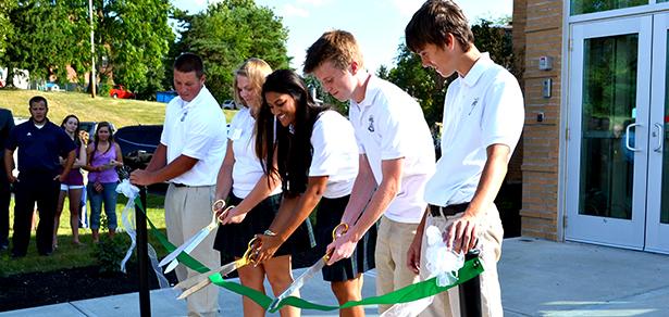 Members of Catholic Central High School's student leadership cut the ribbon on Aug. 14., 2014. (CT Photo/John Stegeman)