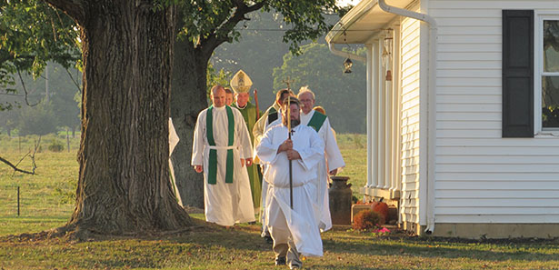"""Archbishop Dennis M. Schnurr and others process in at the opening of the """"Farm Mass"""" Sept. 5 at the farm of Randy Louiso in West Union. (CT Photo/Paul Hannah)"""