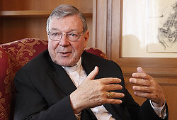 Cardinal George Pell, prefect of the Vatican Secretariat for the Economy, gestures during an interview at the Vatican in this Aug. 5 file photo. In a book to be released just before October's extraordinary Synod of Bishops on the family, Cardinal Pell says he opposes proposed changes to church practice that would allow divorced and civilly remarried Catholics to receive Communion. (CNS photo/Robert Duncan) See PELL-SYNOD Sept. 17, 2014.