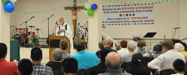 Father Len Wenke celebrates the 11th anniversary Mass for the Holy Family Latino community.