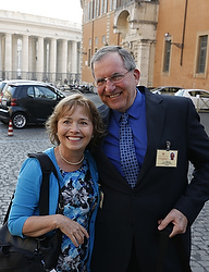 Alice and Jeff Heinzen of Menomonie, Wis., pose for a photo as they arrive for the morning session of the extraordinary Synod of Bishops on the family at the Vatican Oct. 7. The couple are auditors at the synod. (CNS photo/Paul Haring)
