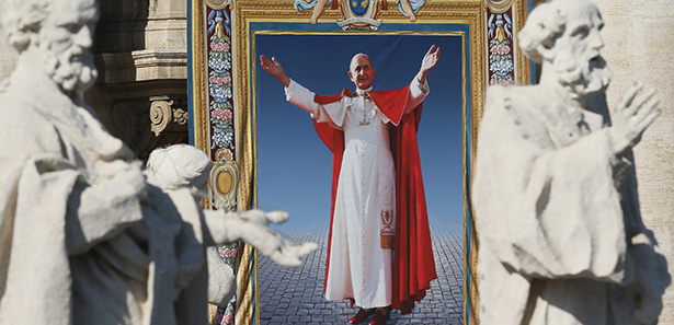 "A tapestry of Blessed Paul VI hangs from the facade of St. Peter's Basilica during his beatification Mass celebrated by Pope Francis in St. Peter's Square at the Vatican Oct. 19. The Mass also concluded the extraordinary Synod of Bishops on the family. Blessed Paul, who served as pope from 1963-1978, is most remembered for his 1968 encyclical, ""Humanae Vitae,"" which affirmed the church's teaching against artificial contraception. (CNS photo/Paul Haring) See BEATIFICATION-MASS Oct. 19, 2014."