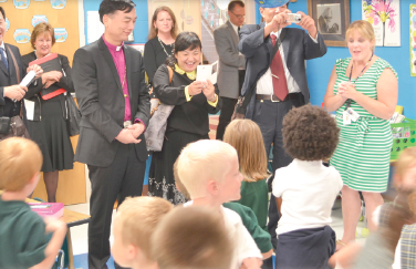 St. Albert the Great Autism Program Director Megan Apple, at left in green dress, waits as an interpreter explains her answer to a question from Bishop Francis Lu Xinping, center. (CT Photo/Steve Trosley)