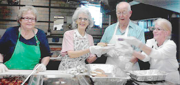 Volunteers at the Walnut Hills Soup Kitchen prepare to serve a meal. (CT Photo/Eileen Connelly, OSU)
