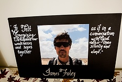 A photo of slain New Hampshire journalist James Foley is displayed during an Oct. 19 memorial Mass celebrated at Our Lady of the Holy Rosary Church in Rochester, N.H. Foley was captured by Syrian extremists in November 2012 and killed Aug. 19 of this year. (CNS photo/Donis Tracy, Pilot) See FOLEY-MASS Oct. 24, 2014.