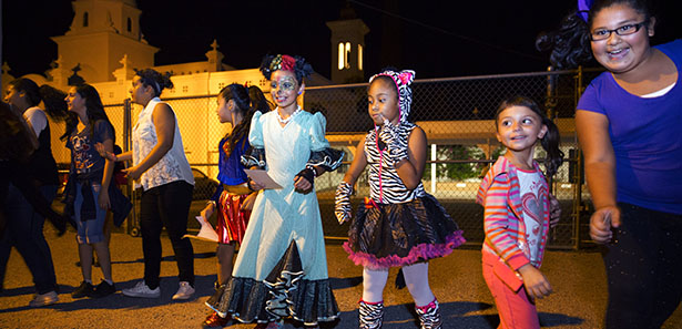 Children dance to music during a Halloween carnival at Santa Cruz Catholic School in Tucson, Ariz., Oct 24. The annual event brought together hundreds of students, parents and neighbors for a night of entertainment and fun. (CNS photo/Nancy Wiechec)
