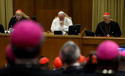 Pope Francis attends the morning session on the final day of the extraordinary Synod of Bishops on the family at the Vatican Oct. 18. At left is Cardinal Lorenzo Baldisseri, general secretary of the Synod of Bishops, and at right Cardinal Peter Erdo of Esztergom-Budapest, Hungary, relator for the synod. (CNS photo/Paul Haring) See SYNOD-MESSAGES and SYNOD-CONCLUSION Oct. 18, 2014.