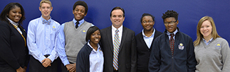 Cincinnati Mayor John Cranley, center, poses with students at DePaul Cristo Rey during a recent visit to the school.