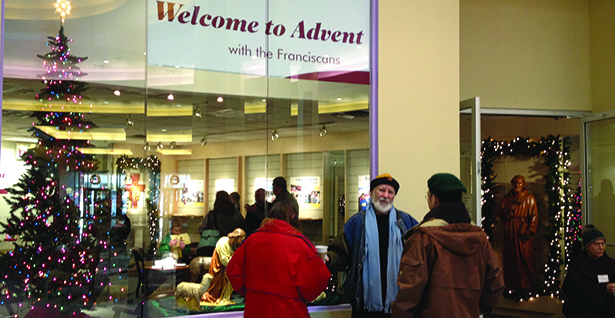 Shoppers gather outside a small ministry run by the Franciscan Friars of the St. John the Baptist province at Cincinnati's Northgate Mall last year. (CT Photo/John Stegeman)