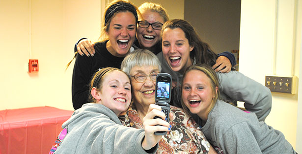 Sister of Notre Dame de Namur Damienne Grismer enjoys a visit with MND students as part of the Adopt-A-Sister Club. (CT Photo/Walt Schaefer)
