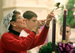 Sharon Borgert, Consecrated Virgin in the World, lights an Advent candle during the Mass for the Opening of the Year of Consecrated Life at Emmanuel Catholic Church in Dayton Sunday, Nov. 30, 2014. (CT Photo/E.L. Hubbard)