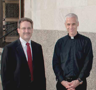Tom Liehart, left, poses with Archdiocese of Cincinnati Chancellor Father Steve Angi outside St. Louis Church in downtown Cincinnati. (Courtesy Photo)