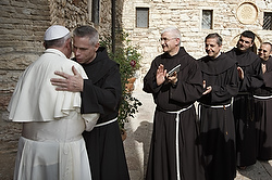 "U.S. Franciscan Father Michael Perry, minister general of the Order of Friars Minor, embraces Pope Francis during his 2013 visit to Assisi, Italy. Ineffective budgetary oversight and ""questionable"" financial activities have plunged the Order of Friars Minor into significant debt and an extremely serious financial situation, Father Perry said. (CNS photo/Paul Haring)"
