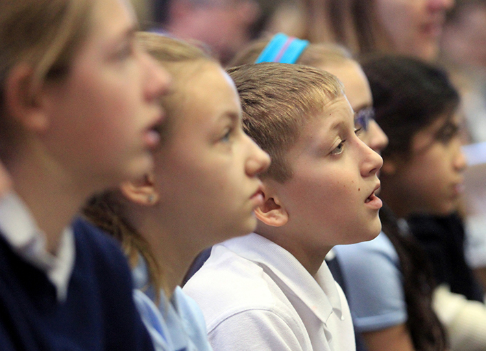 Students sing during the Catholic Schools Mass at Our Lady of the Immaculate Conception Church in Dayton Wednesday, Jan. 28, 2015. (CT Photo/E.L. Hubbard)