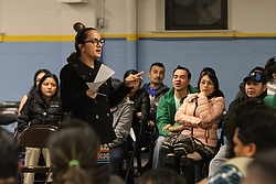 Paralegal Maria Alejandra McKee addresses the audience at St. John the Evangelist Church in Riverhead, N.Y., Jan. 18 during an information session on immigration reform based on President Barack Obama's executive actions. A group of Catholic leaders urged fellow Catholics in Congress to set aside partisan bickering and support the U.S. bishops' efforts on behalf of comprehensive immigration reform, calling it a sanctity of life issue and an important step in building a culture of life. (CNS photo/Gregory A. Shemitz)