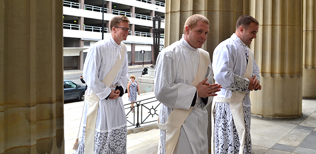 Then-deacons Ethan Moore, Eric Wood and Adrian Hilton process into the Cathedral of St. Peter in Chains May 16 prior to their ordinations as priests. (CT Photo/John Stegeman)
