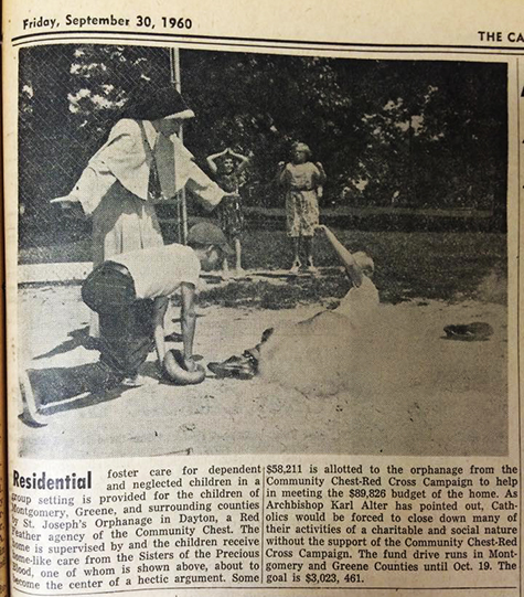 A Sister of the Precious Blood calls a young boy safe as he slides into home plate in this 1960 photograph. (CT File/Throwback Thursday)