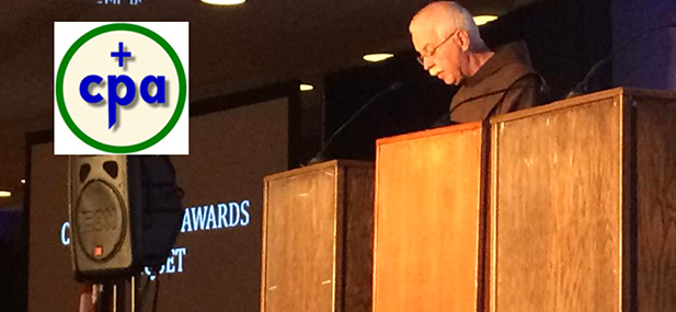 Father Pat McCloskey, of St. Anthony Messenger and chairman of the awards committee, speaks during the Catholic Press Association awards banquet in Buffalo, N,Y, June 26.. (CT Photo/John Stegeman)