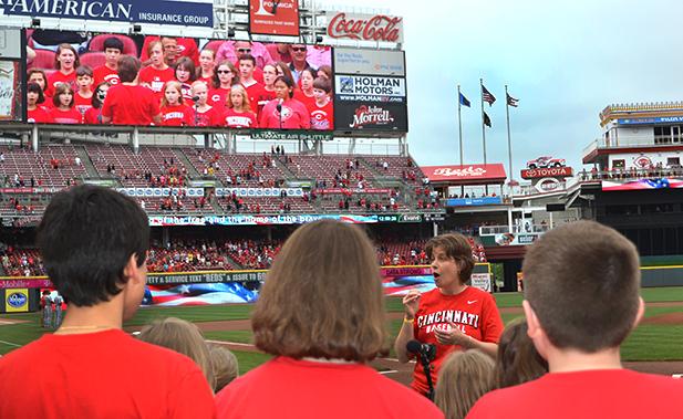 Mary Ella Wielgos, facing camera, directs the St. Maximilian Children's Choir before a Reds game May 31. (CT Photo/John Stegeman)
