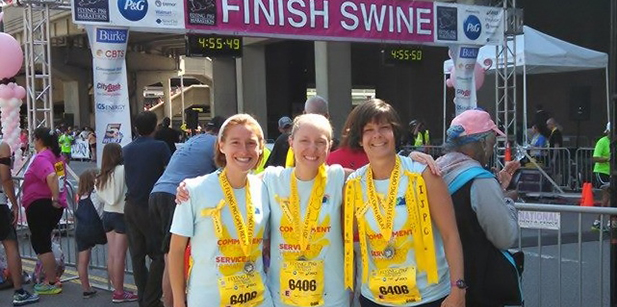 Sisters of Charity Annie Klapheke, left, Tracy Kemme, and Andrea Koverman, took part in the four-person relay during the Flying Pig Marathon. Congregation of Divine Providence Sister Leslie Keener, not pictured, was also on the relay team. (Courtesy Photo)