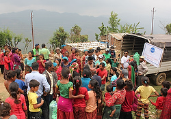Relief workers from the St. Vincent de Paul Society of Assumption Parish in Kathmandu, Nepal, distribute food items and tents May 9 for Hindus and Muslims on top of Baretol mountain in Kathmandu. The village was affected by the magnitude-7.3 earthquake April 25. (CNS photo/Anto Akkara)