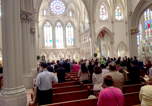 Attendees of the Catholic Media Conference worship at the opening night Mass at St. Joseph's Cathedral. Mass was celebrated by Bishop Richard J. Malone. (CT Photo/John Stegeman)