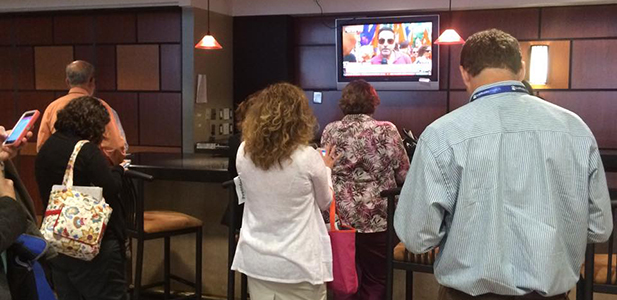 Attendees of the Catholic Media Conference in Buffalo, New York watch coverage of the Supreme Court's decision to legalize same-sex marriage. (CT Photo/John Stegeman)