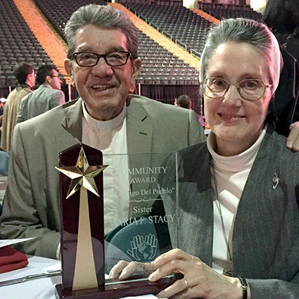 Sister Maria Francine Stacy, SND, Director of Catholic Hispanic Ministries in the Dayton area, shown here with Fr. Samuel Gonzales, was given the El Amigo del Pueblo award from Wright State University's Office of Latino Affairs. (Courtesy Photo)