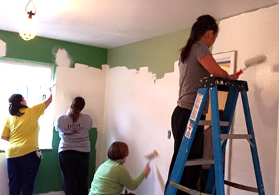 Teachers from St. Teresa of Avila Catholic school used an in-service day to paint the home. (Courtesy Photo/HFHGC)