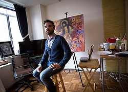 Essa Neima poses for a photo in his art studio in Washington.  The Syrian artist said he got the idea to showcase his countryÕs struggles after extremists killed a Jesuit priest friend there. (CNS photo/Tyler Orsburn)