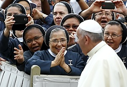 Nuns greet Pope Francis as he arrives to lead his weekly general audience in St. Peter's Square at the Vatican June 24. (CNS photo/Tony Gentile, Reuters)