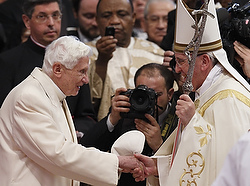 Retired Pope Benedict XVI greets Pope Francis at the conclusion of a consistory at which Pope Francis created 19 new cardinals in St. Peter's Basilica at the Vatican Feb. 22. Pope Benedict's unexpected presence at the ceremony marked the first time he had joined Pope Francis for a public liturgy. (CNS photo/Paul Haring)