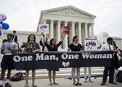 Supporters of traditional marriage between a man and a woman rally in front of the U.S. Supreme Court in Washington June 26, shortly before the justices handed down a 5-4 ruling that states must license same-sex marriages and must recognize same-sex marriages performed in other states. (CNS photo/Joshua Roberts, Reuters)