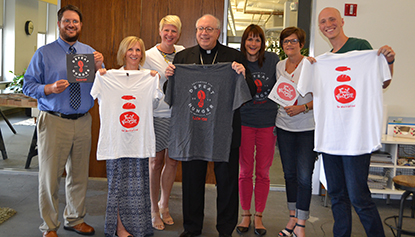 Archdiocese of Cincinnati and HyperQuake staff pose for a photo. From left are archdiocese Office of the New Evangelization Director Sean Ater, HyperQuake CFO Jeanne Bruce, HyperQuake Director of Client Leadership Sheri Ernst, Bishop Binzer, HyperQuake Design Director Holly Shoemaker, archdiocese Marketing Advisor Mimi London and HyperQuake Brand Designer Nathan Schwecke. (CT Photo/John Stegeman)