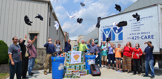 Representatives of Stelter and Brinck, JTM Food Group, and various Catholic institutions celebrate the kick off event of the Food for All campaign Tuesday at the Stelter and Brinck offices in Harrison, Ohio. (CT Photo/John Stegeman)