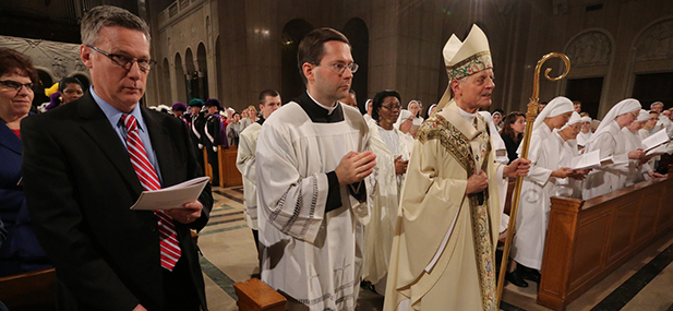 Washington Cardinal Donald W. Wuerl walks to the altar at the start of a July 4 Mass at the Basilica of the National Shrine of the Immaculate Conception in Washington. He was the main celebrant of the Mass on the final day of the U.S. bishops' Fortnight for Freedom campaign. (CNS photo/Bob Roller)