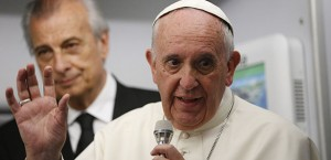 Pope Francis answers questions from journalists aboard his flight from Asuncion, Paraguay, to Rome July 12. (CNS photo/Paul Haring)