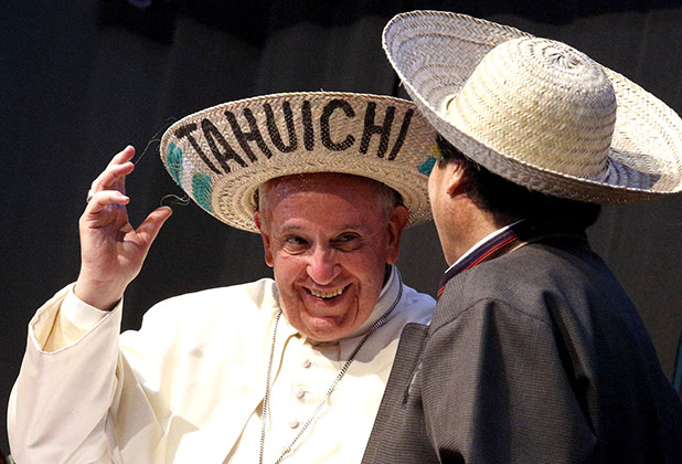 Pope Francis and Bolivian President Evo Morales try on traditional hats as they participate in the second World Meeting of Popular Movements in Santa Cruz, Bolivia, July 9. Pope Francis is on a July 5-12 visit to Latin America. (CNS photo/Paul Haring)