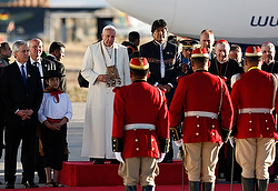 Pope Francis reviews an honor guard with Bolivian President Evo Morales at El Alto International Airport in La Paz, Bolivia, July 8. The airport is at 13,325 feet above sea level. (CNS photo/Paul Haring)