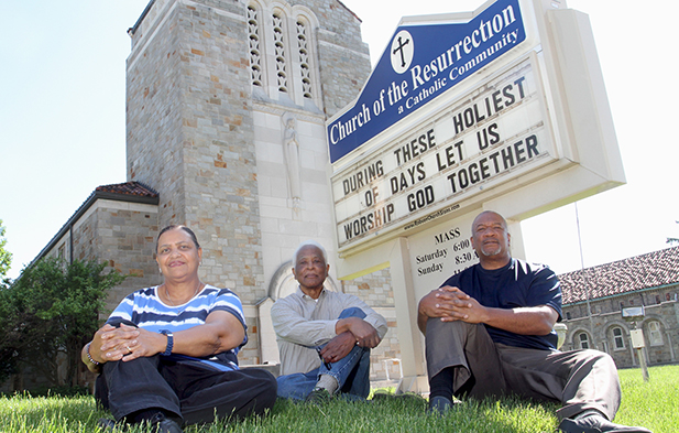 Tess Wilfong, left, John Jones and Deacon Royce Winters pose in front of the Church of the Resurrection. The parish will be celebrating its fifth year anniversary Mass in early August. (CT Photo/E.L. Hubbard)