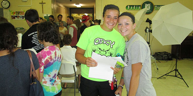 Badin High School seniors Danielle Ray and Lexi Wurzelbacher were two of more than 140 seniors who picked up their schedules Tuesday at the Catholic high school in Hamilton. They are members of what will be Badin's 50th graduating class. (Courtesy Photo)